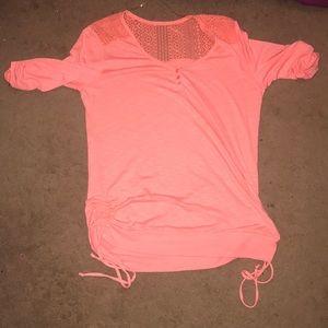 light pink/peach medium sleeved shirt.